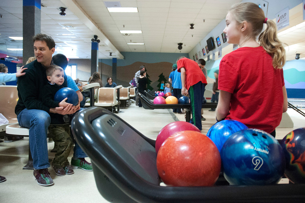 Description of . Kayla Rice/Reformer Keith Tylecki of Fairfax, Va. sits with his son Andrew Tylecki, 3, and Genavie Cobb, 10, of Vernon while bowling at Brattleboro Bowl on Tuesday afternoon.