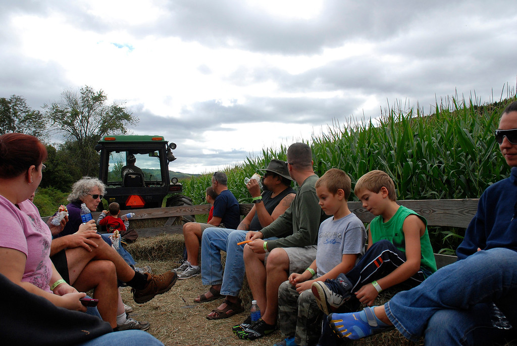 Description of . Kayla Rice/Reformer Visitors take a hayride at Gaines Farm in Guilford.