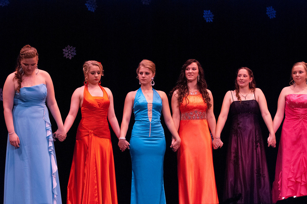 Description of . Kayla Rice/Reformer Queen contestants await the winner announcement during the 2014 Brattleboro Winter Carnival Queen's Pageant on Friday evening.