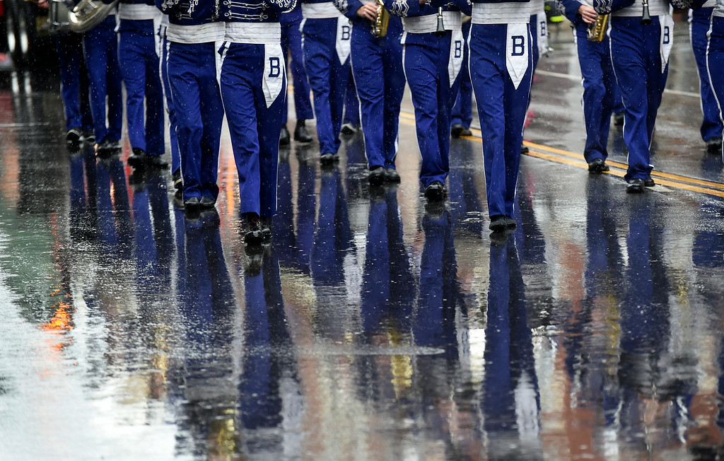 Description of . Kayla Rice/Reformer Members of the Brattleboro Union High School band are reflected in the wet pavement while they march in the Fourth of July parade in Brattleboro on Friday.