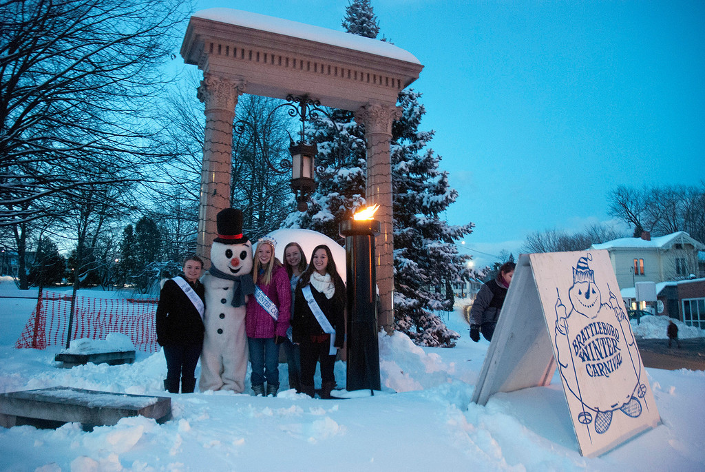Description of . Kayla Rice/Reformer Brattleboro Winter Carnival's 2013 Queen, Allison Cornellier stands with three of the 2014 Queen's Pageant participants and Frosty the Snowman during the torch lighting ceremony at Well's Fountain in Brattleboro on Friday.