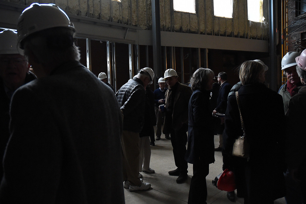 Description of . Kayla Rice/Reformer Supporters of the Brooks House project wait to be led on a tour of the building's construction progress on Thursday afternoon.