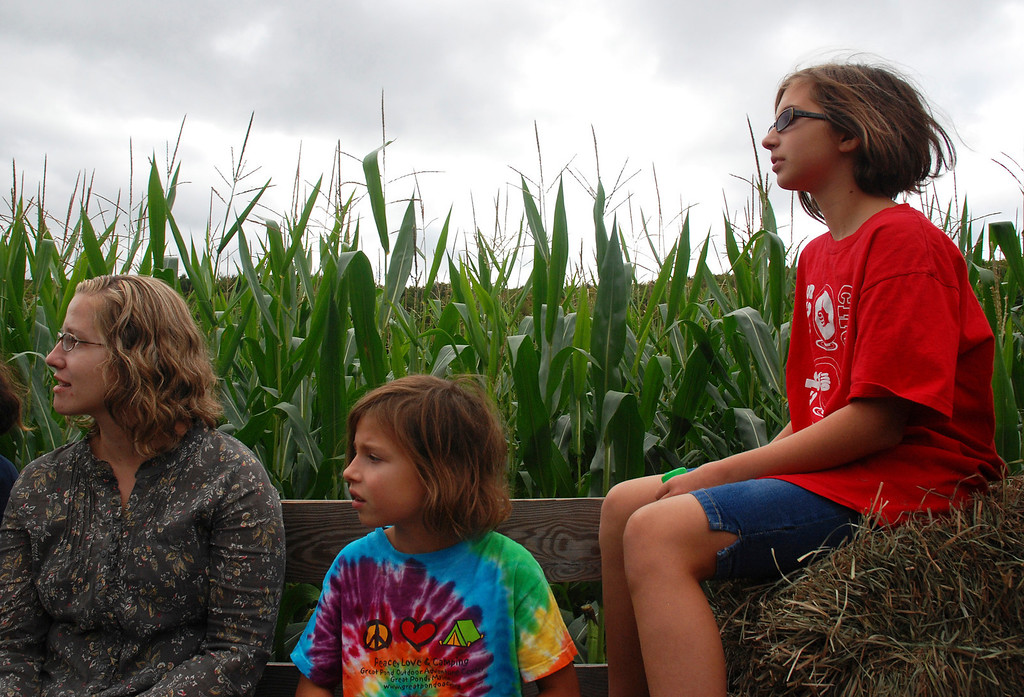 Description of . Kayla Rice/Reformer Julia (left) and her nieces, Meadow, 8, and Hanna, 11, of Kittery, Maine, take a hayride at Gaines Farm in Guilford.
