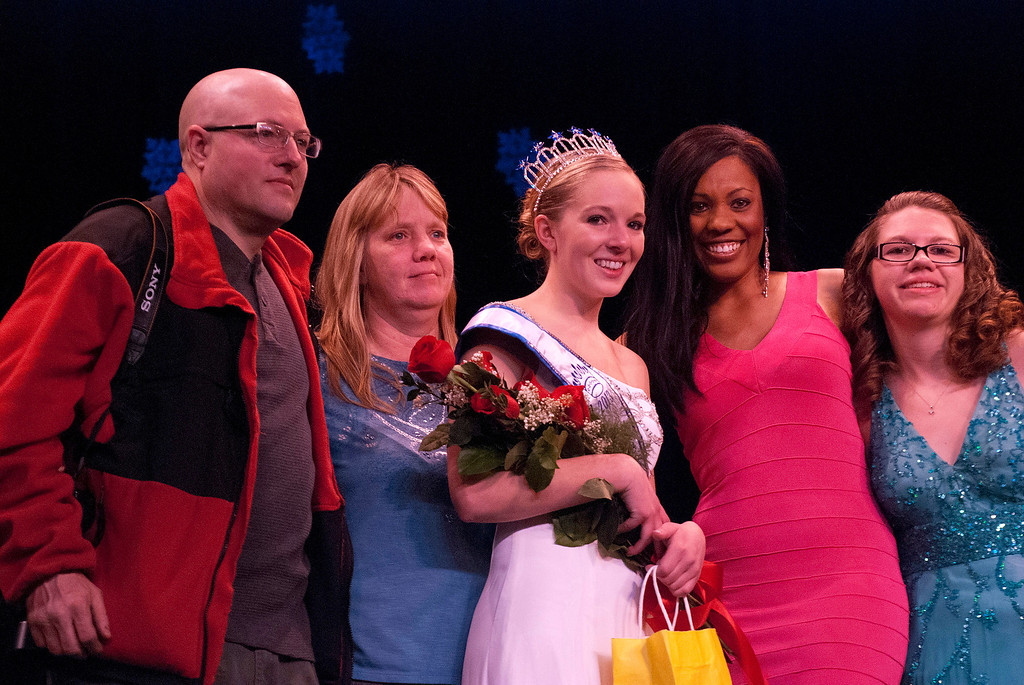 Description of . Kayla Rice/Reformer 2013 Winter Carnival Queen Alison Cornellier stands with her parents and pageant directors before preparing to pass on the crown during the 2014 Brattleboro Winter Carnival Queen's Pageant on Friday evening.