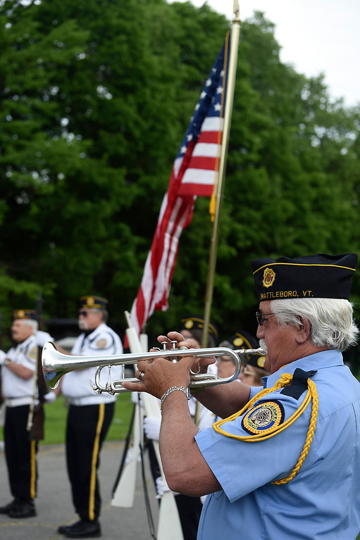 """. Kayla Rice/Reformer Don Strange of American Legion Post 5 performs \""""Taps\"""" during the Memorial Day Service at St. Michael\'s cemetery in Brattleboro."""