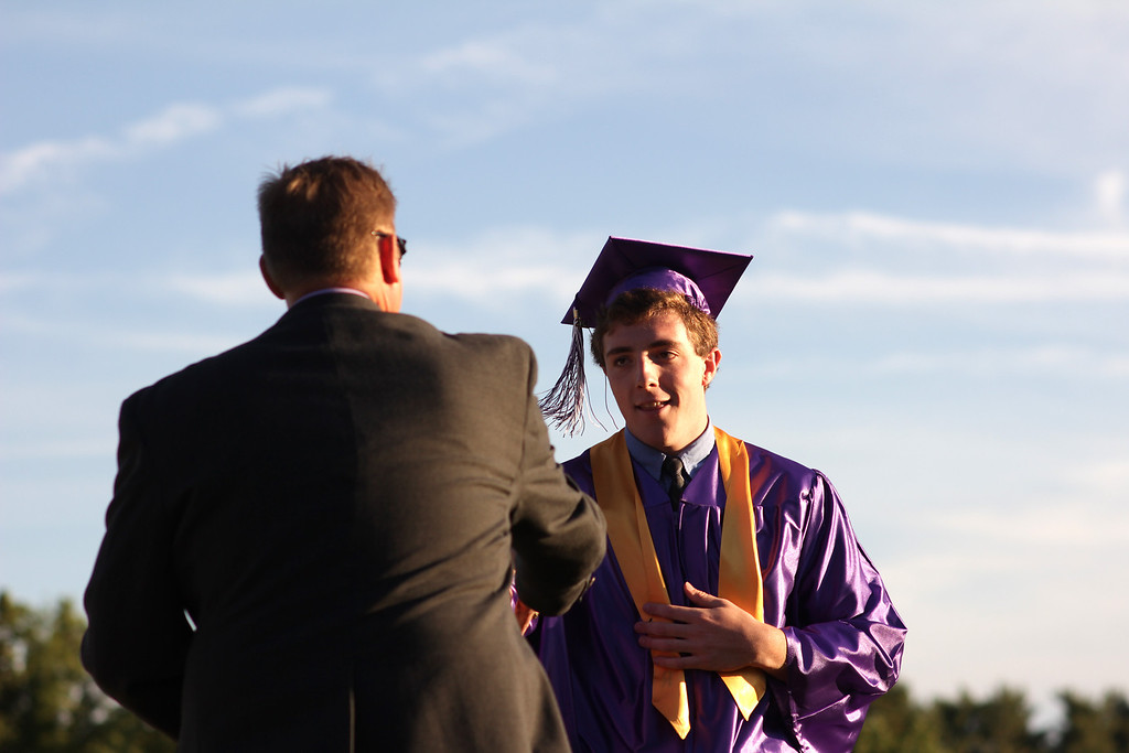 . Photo by Nick Grubinger Colby McGinn receives an award at the BUHS graduation ceremony on Friday evening.