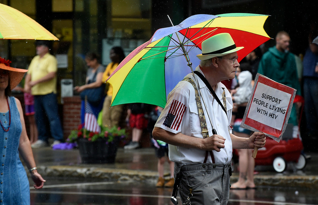 . Kayla Rice/Reformer A man walks with the Aids Project of Southern Vermont in the Brattleboro Fourth of July parade on Friday.