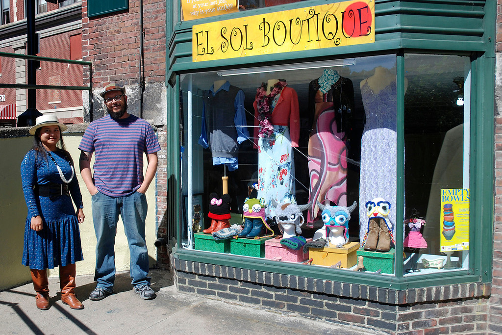 . Kayla Rice/Reformer New owners El and David Solin of El Sol Boutique outside their shop on Main St. in Brattleboro.