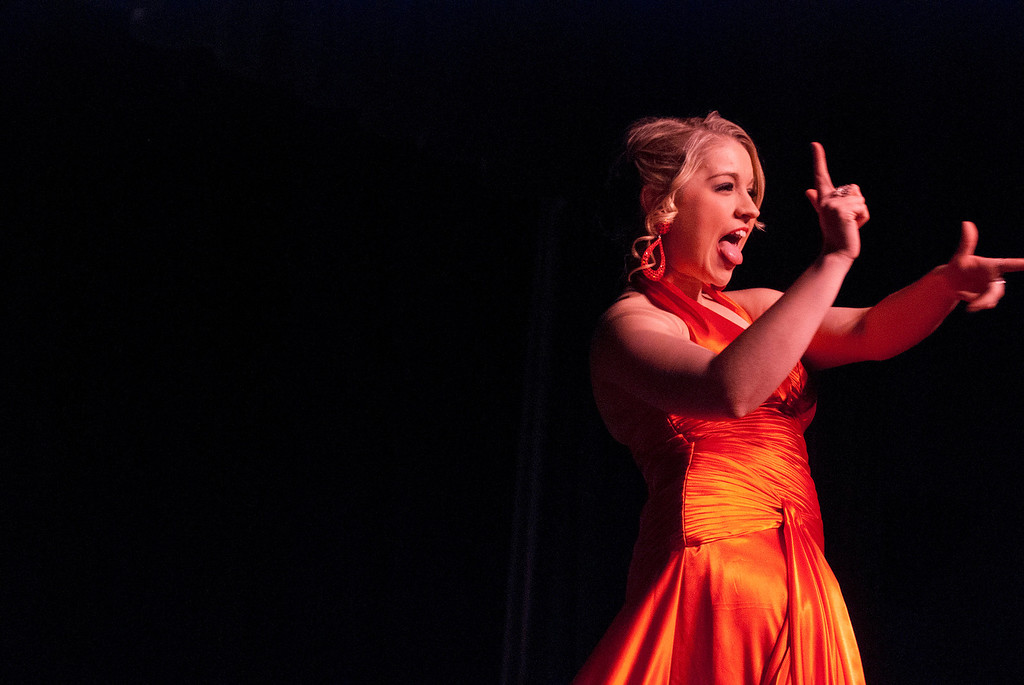 . Kayla Rice/Reformer Kara Walsh shoots some finger guns while walking down the runway during the 2014 Brattleboro Winter Carnival\'s Queen\'s Pageant on Friday night.