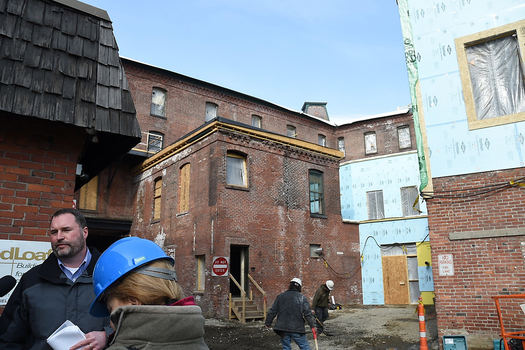. Kayla Rice/Reformer Ben Taggard of Mesabi LLC speaks to members of the media before a tour of the Brooks House to show the progress of the historic building\'s re-construction on Thursday afternoon.