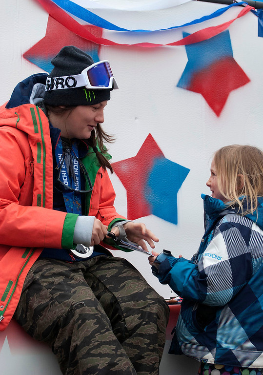 ". Kayla Rice/Reformer                                 Elaina Krusiewski, 8, of Dover gets an autograph from Mount Snow athlete and Olympic silver medalist Devin Logan before the ""Devin Day\"" parade and celebration in Dover on Saturday."