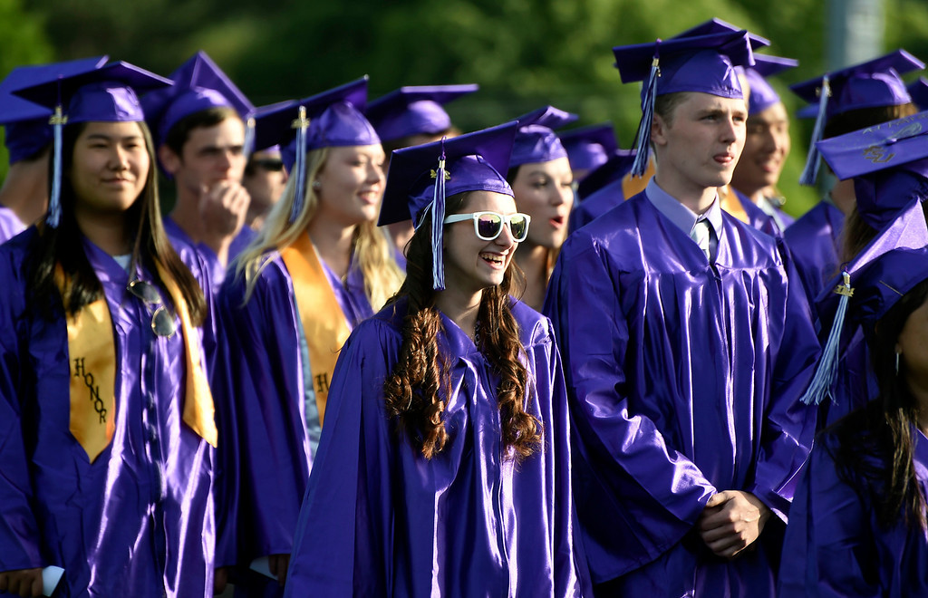 . Kayla Rice/Reformer Graduating seniors stand during the BUHS graduation ceremony on Friday evening.