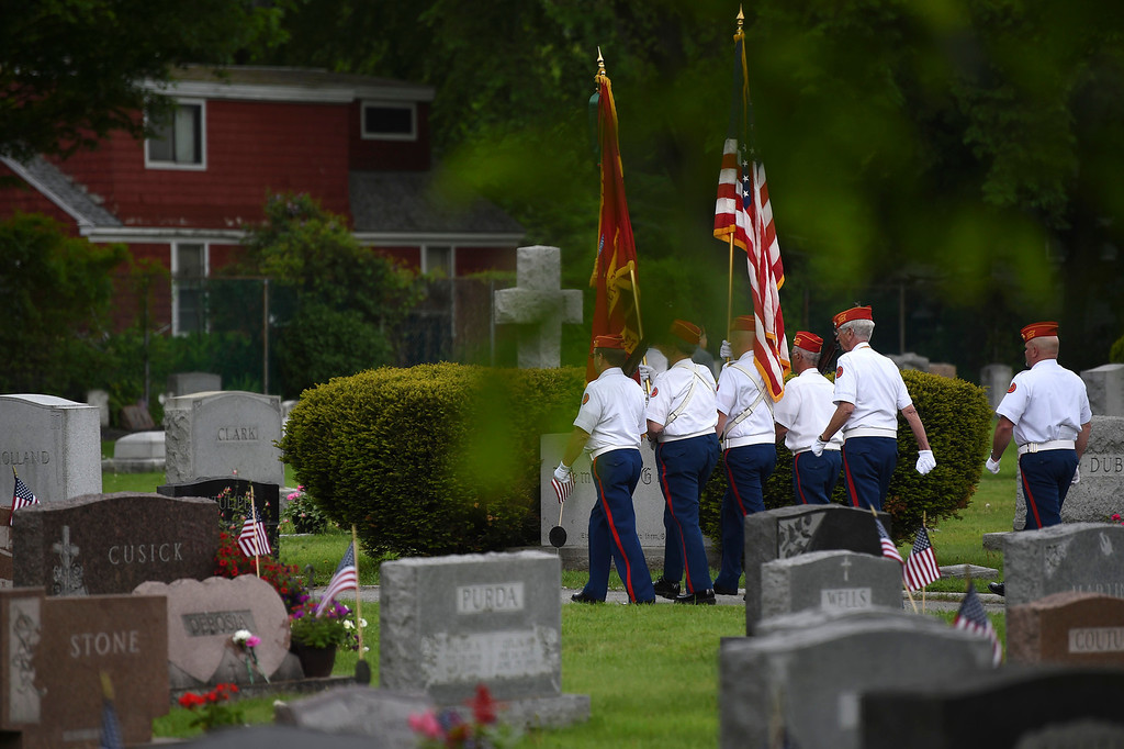 . Kayla Rice/Reformer Members of Detachment 798 of the Marine Corps. League march in during the Memorial Day service at St. Michael\'s cemetery in Brattleboro on Monday morning.