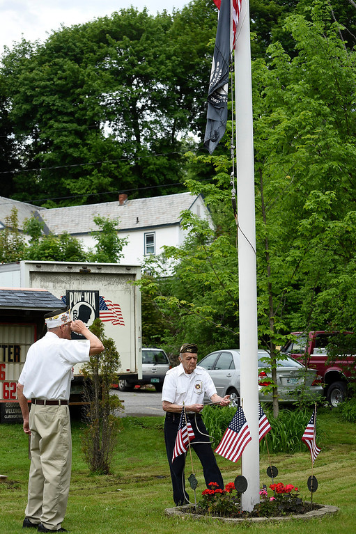 . Kayla Rice/Reformer Veterans from the Hinsdale VFW participate in the flag raising after the Hinsdale Memorial Day parade on Monday morning.
