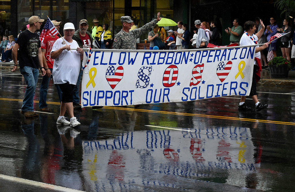 . Kayla Rice/Reformer Members of the Yellow Ribbon Operation walk down Main St. in the Brattleboro Fourth of July parade on Friday.