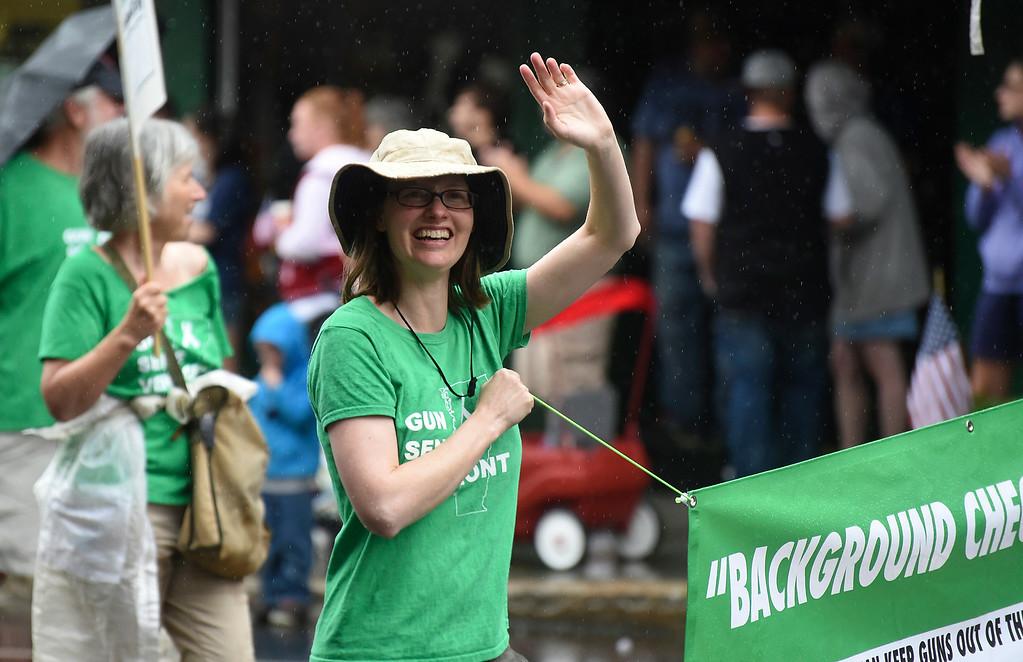 ". Kayla Rice/Reformer Ann Braden walks with her organization, \""Gun Sense Vermont\"" in the Brattleboro Fourth of July parade on Friday."