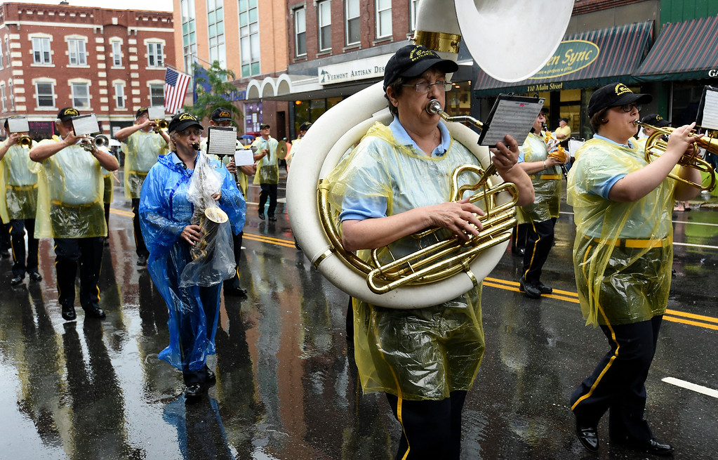 . Kayla Rice/Reformer The American Legion band braves the wet weather to march in the Brattleboro Fourth of July parade on Friday.