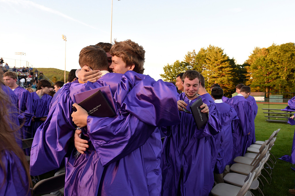 . Kayla Rice/Reformer Graduates from BUHS hug after graduating on Friday evening.