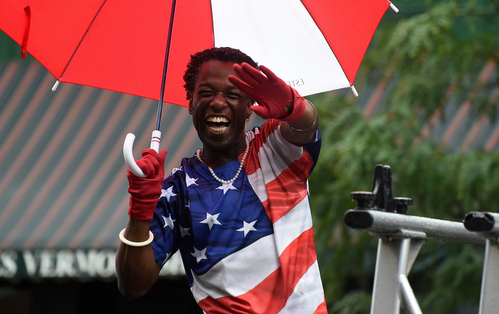 . Kayla Rice/Reformer Alfred Hughes smiles and waves in the Brattleboro Fourth of July parade on Friday.