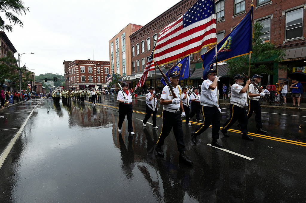 . Kayla Rice/Reformer Members of the Brattleboro American Legion Post 5 walk in the Brattleboro Fourth of July parade on Friday.
