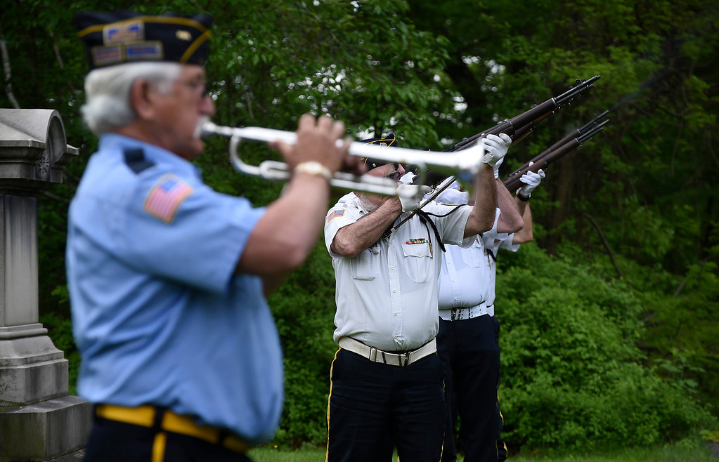 . Kayla Rice/Reformer Members of the Brattleboro VFW Honor Guard shoot their rifles into the air during the Memorial Day service at Prospect Hill cemetery in Brattleboro on Monday morning.