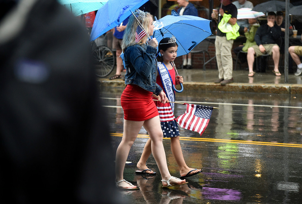 . Kayla Rice/Reformer The 2014 Winter Carnival queen and princess walk in the Brattleboro Fourth of July parade on Friday.