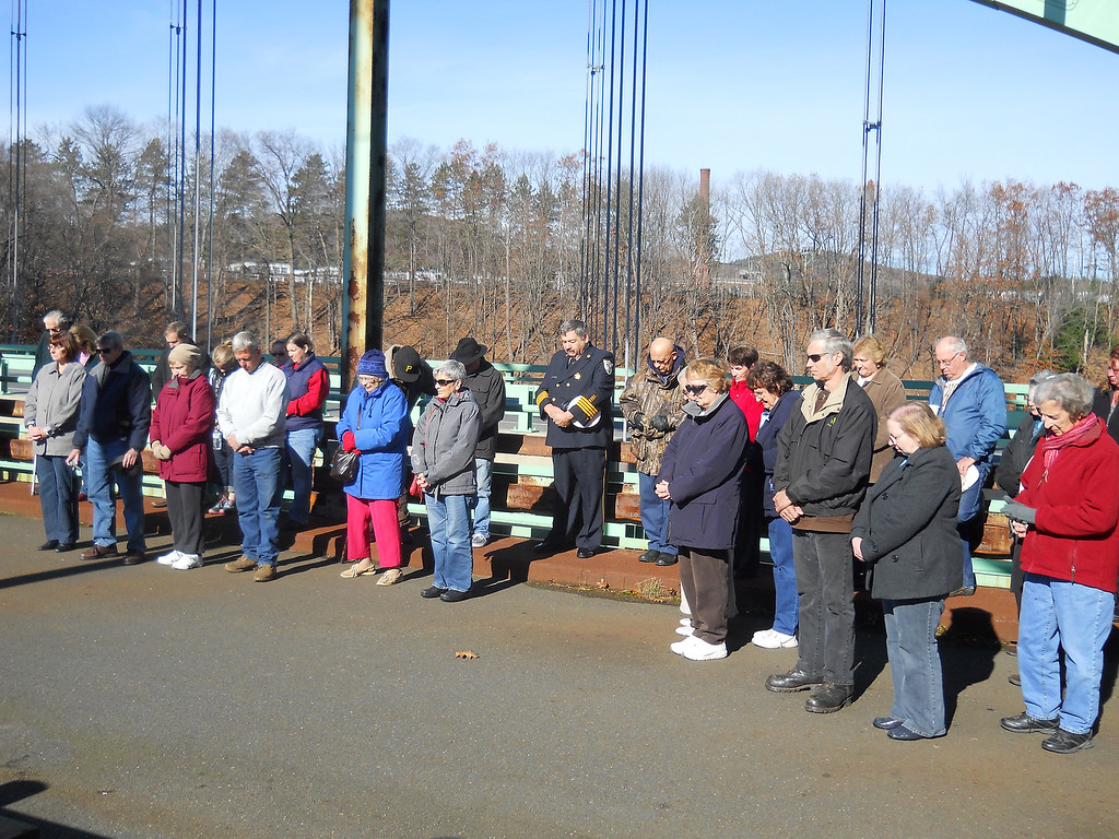 . Domenic Poli/Reformer Attendees bow their heads during the opening prayer at the Veterans Day service in Chesterfield.
