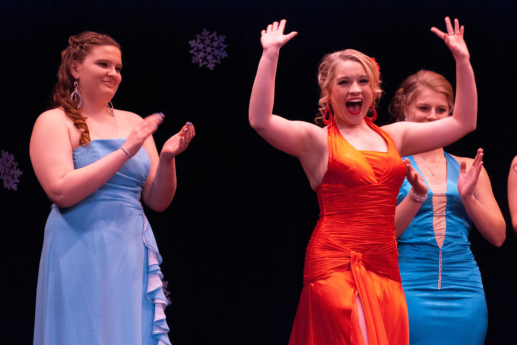 . Kayla Rice/Reformer Kara Walsh reacts after being announced as the 2014 Winter Carnival Queen during the Queen\'s pageant on Friday evening.