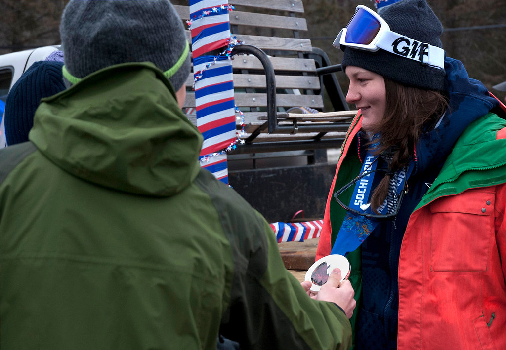 ". Kayla Rice/Reformer                                 Mount Snow athlete and Olympic silver medalist Devin Logan lets fans take a look at her silver medal during the ""Devin Day\"" celebration and parade in Dover on Saturday."