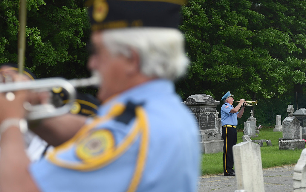 """. Kayla Rice/Reformer Members of the American Legion Post 5 perform \""""Taps\"""" during the Memorial Day Services at St. Michael\'s cemetery in Brattleboro."""