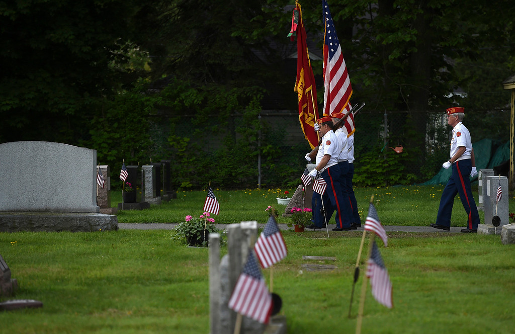 . Kayla Rice/Reformer Members of Detachment 798 of the Marine Corps. League march out following the Memorial Day service at St. Michael\'s cemetery in Brattleboro on Monday morning.