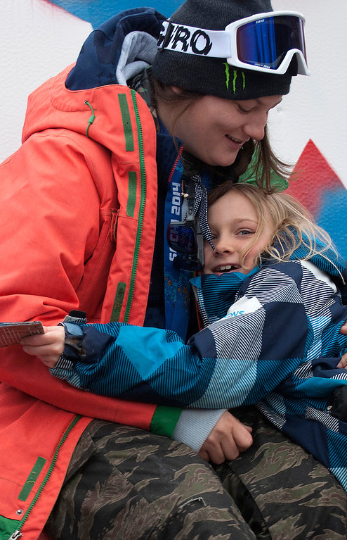 ". Kayla Rice/Reformer                                 Elaina Krusiewski, 8, of Dover hugs Mount Snow athlete and Olympic silver medalist Devin Logan after getting her autograph before the ""Devin Day\"" parade and celebration in Dover on Saturday."